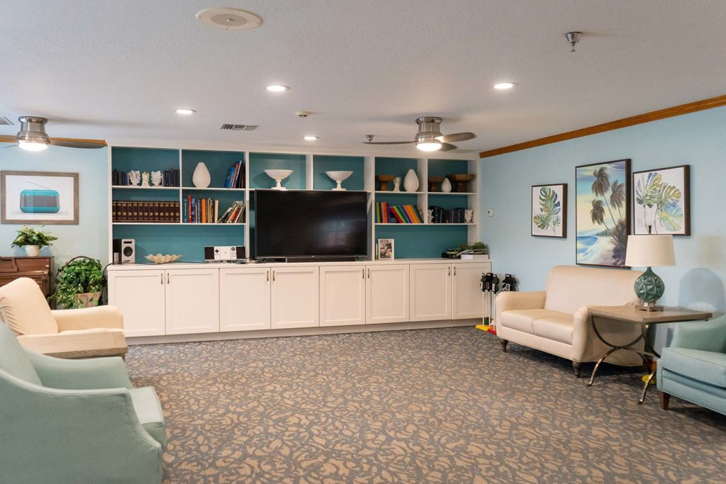 Gathering room with TV at Heron House assisted living and memory care community in Sarasota, FL