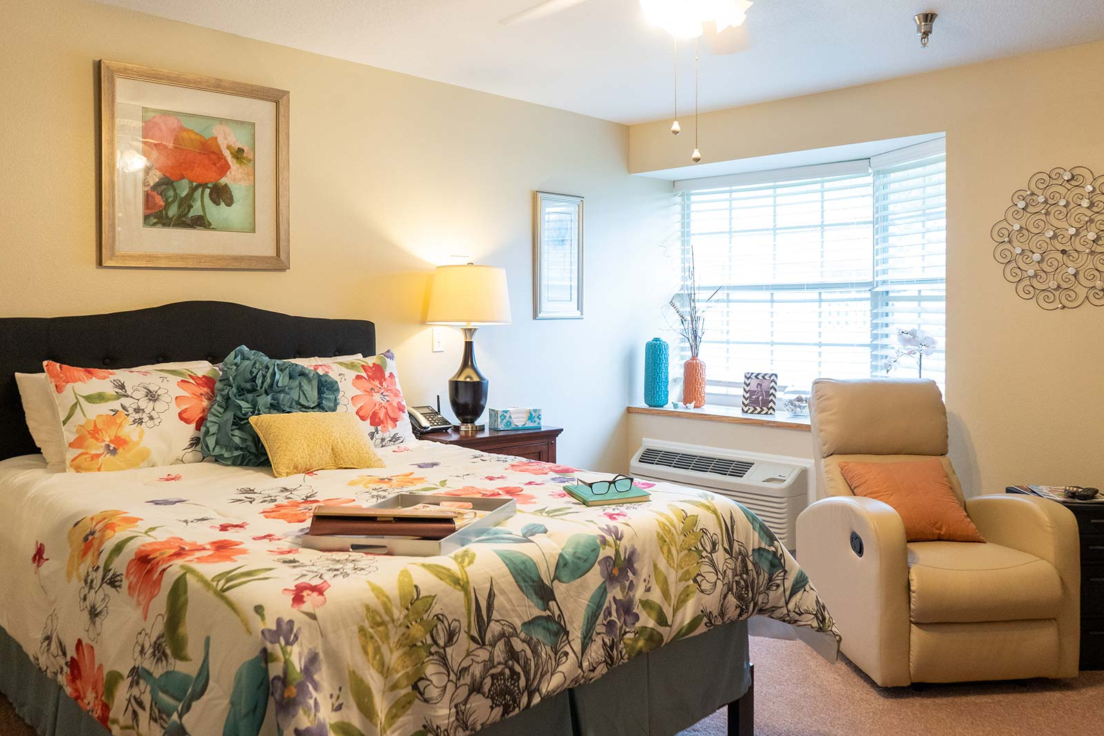 Model apartment bedroom at Heron House assisted living and memory care community in Sarasota, FL