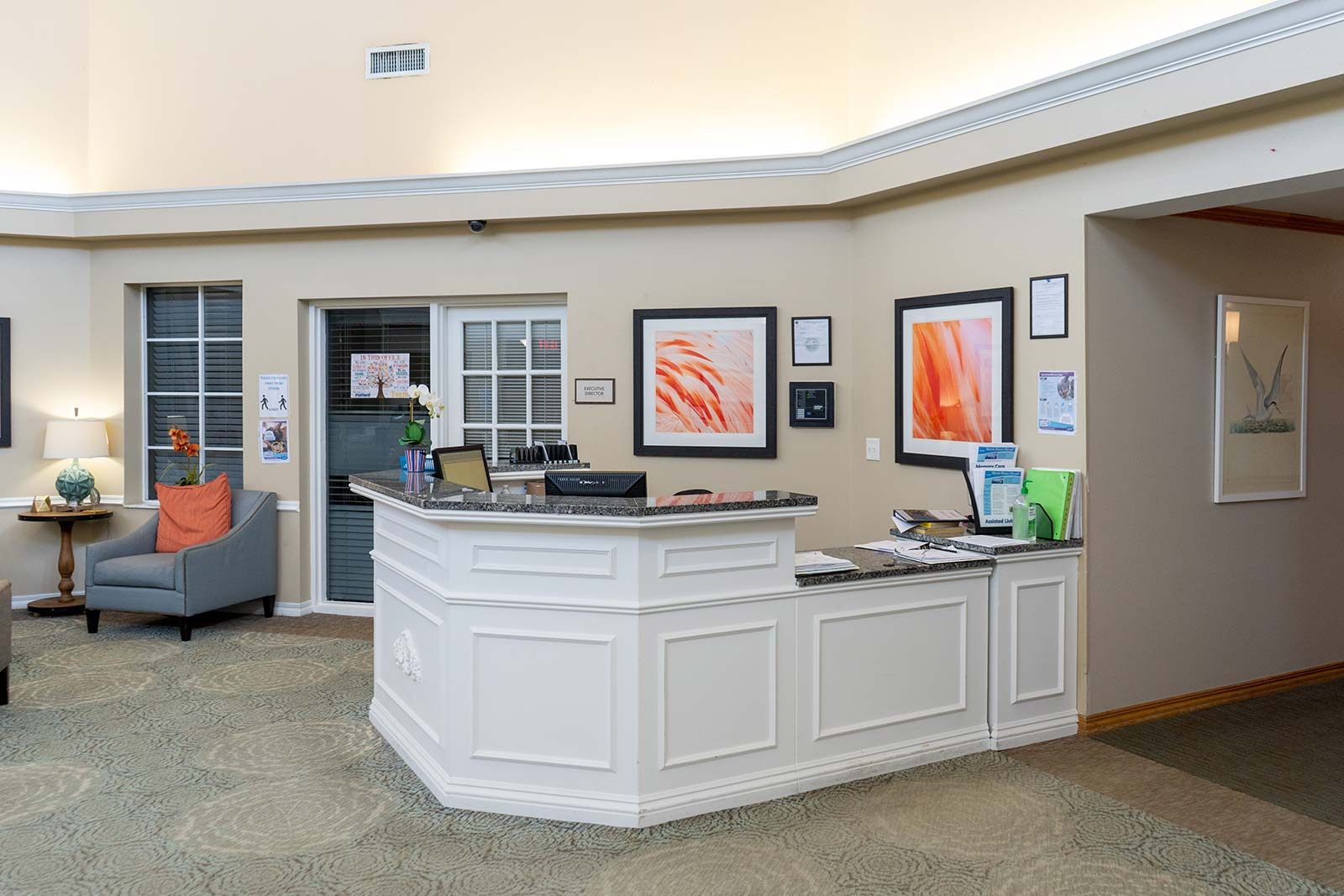Concierge desk at Heron House assisted living and memory care community in Sarasota, FL