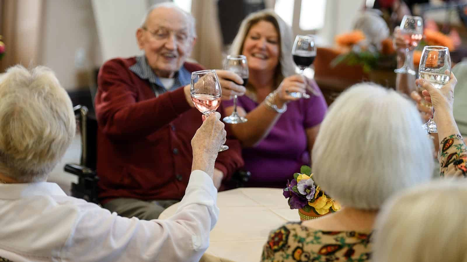 Senior group toasting wine