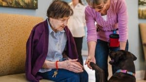 Senior woman with therapy dog