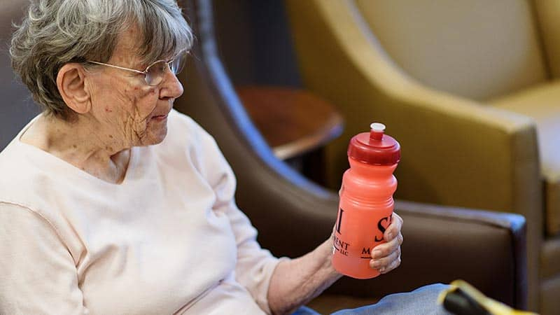 Senior woman holding Mighty Shake