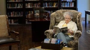 Senior woman reading in library
